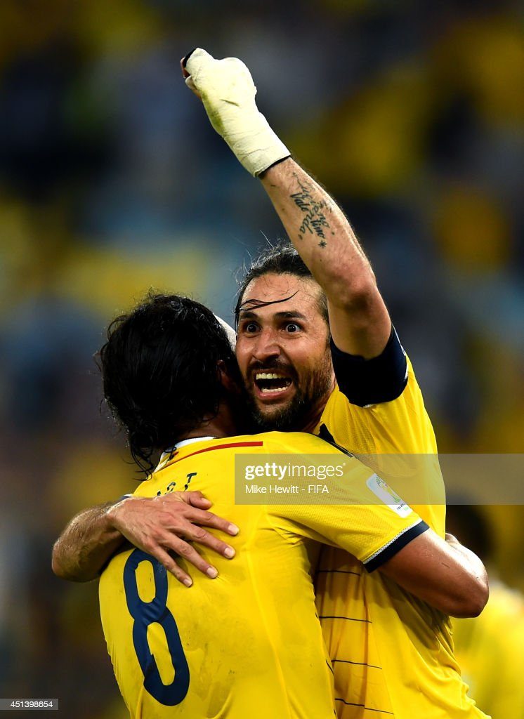<a gi-track='captionPersonalityLinkClicked' href=/galleries/search?phrase=Mario+Yepes&family=editorial&specificpeople=648682 ng-click='$event.stopPropagation()'>Mario Yepes</a> (R) and <a gi-track='captionPersonalityLinkClicked' href=/galleries/search?phrase=Abel+Aguilar&family=editorial&specificpeople=2309935 ng-click='$event.stopPropagation()'>Abel Aguilar</a> of Colombia celebrate the 2-0 win after the 2014 FIFA World Cup Brazil Round of 16 match between Colombia and Uruguay at Maracana on June 28, 2014 in Rio de Janeiro, Brazil.