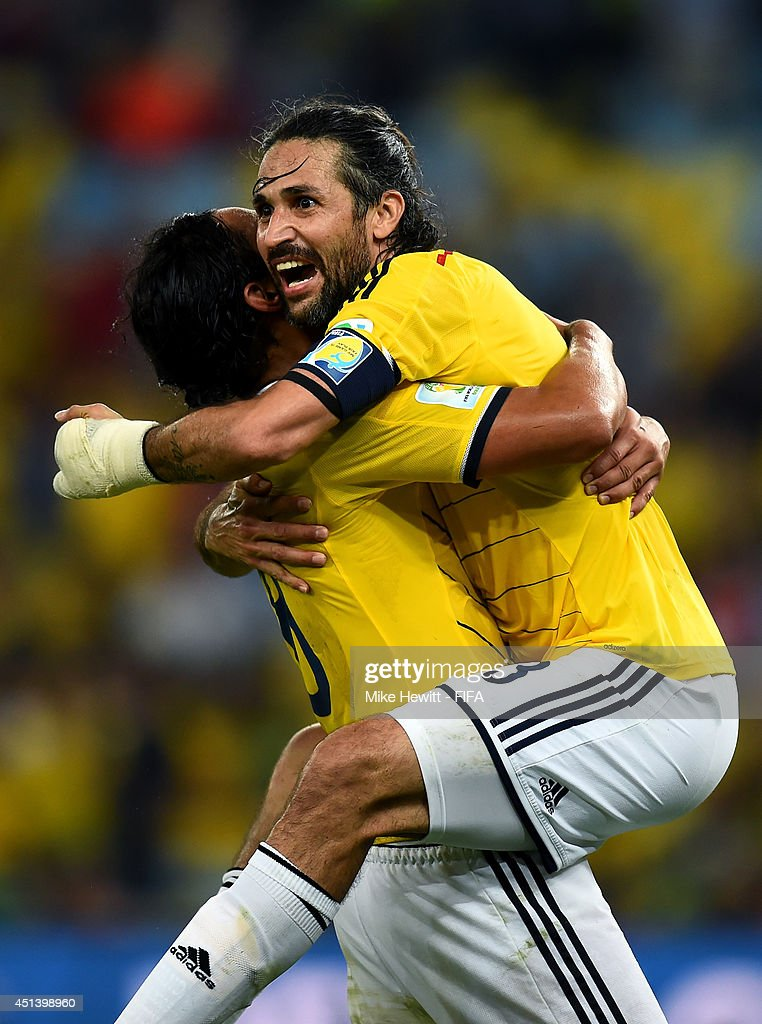 <a gi-track='captionPersonalityLinkClicked' href=/galleries/search?phrase=Mario+Yepes&family=editorial&specificpeople=648682 ng-click='$event.stopPropagation()'>Mario Yepes</a> (R) and <a gi-track='captionPersonalityLinkClicked' href=/galleries/search?phrase=Abel+Aguilar&family=editorial&specificpeople=2309935 ng-click='$event.stopPropagation()'>Abel Aguilar</a> (L) of Colombia celebrate the 2-0 win after the 2014 FIFA World Cup Brazil Round of 16 match between Colombia and Uruguay at Maracana on June 28, 2014 in Rio de Janeiro, Brazil.