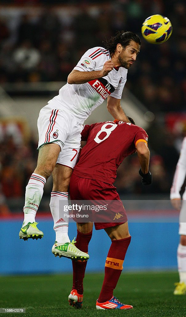 Mario Yepes (L) of AC Milan competes for the ball with Erik Lamela of AS Roma during the Serie A match between AS Roma and AC Milan at Stadio Olimpico on December 22, 2012 in Rome, Italy.