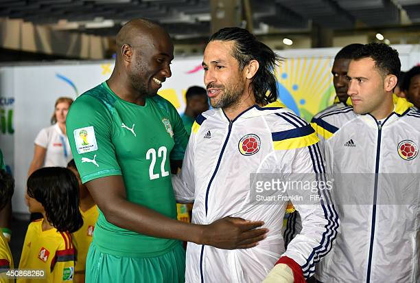 Mario Yepes of Colombia and Sol Bamba of the Ivory Coast speak in the tunnel prior to the 2014 FIFA World Cup Brazil Group C match between Colombia...