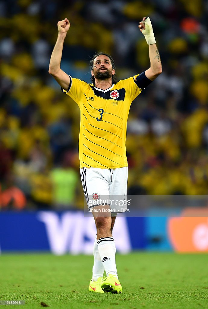 <a gi-track='captionPersonalityLinkClicked' href=/galleries/search?phrase=Mario+Yepes&family=editorial&specificpeople=648682 ng-click='$event.stopPropagation()'>Mario Yepes</a> of Colombia celeberates the 2-0 win after the 2014 FIFA World Cup Brazil Round of 16 match between Colombia and Uruguay at Maracana on June 28, 2014 in Rio de Janeiro, Brazil.