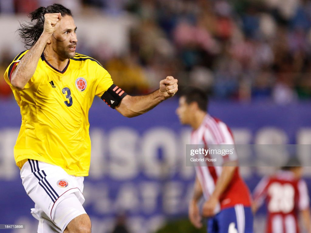 <a gi-track='captionPersonalityLinkClicked' href=/galleries/search?phrase=Mario+Yepes&family=editorial&specificpeople=648682 ng-click='$event.stopPropagation()'>Mario Yepes</a> of Colombia celebrates the first goal during a match between Paraguay and Colombia as part of the 18th round of the South American Qualifiers at Defensores del Chaco Stadium on October 15, 2013 in Asuncion, Paraguay.