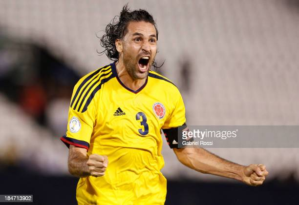 Mario Yepes of Colombia celebrates the first goal during a match between Paraguay and Colombia as part of the 18th round of the South American...