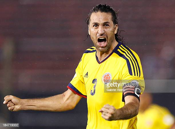 Mario Yepes of Colombia celebrates the second goal during a match between Paraguay and Colombia as part of the 18th round of the South American...