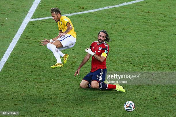 Mario Yepes of Colombia challenges Neymar of Brazil during the 2014 FIFA World Cup Brazil Quarter Final match between Brazil and Colombia at Castelao...
