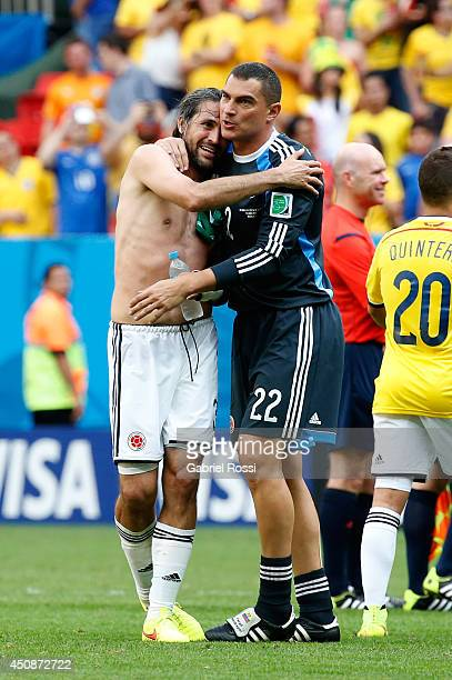 Mario Yepes of Colombia hugs teammate Faryd Mondragon after defeating the Ivory Coast 21 during the 2014 FIFA World Cup Brazil Group C match between...