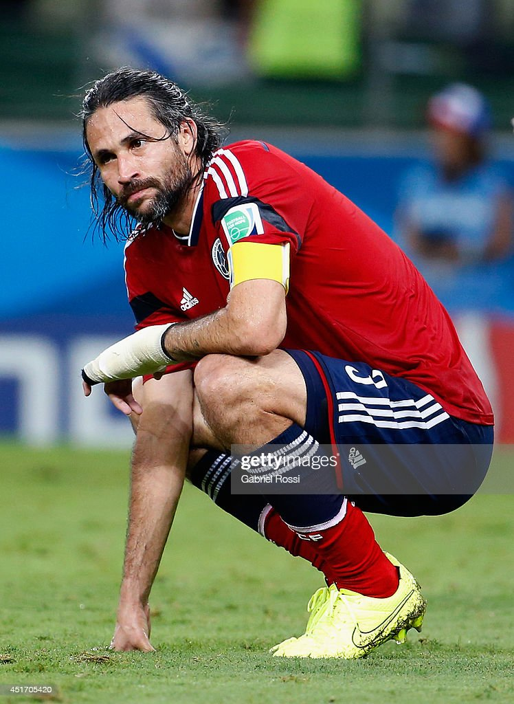 <a gi-track='captionPersonalityLinkClicked' href=/galleries/search?phrase=Mario+Yepes&family=editorial&specificpeople=648682 ng-click='$event.stopPropagation()'>Mario Yepes</a> of Colombia reacts after being defeated by Brazil 2-1 during the 2014 FIFA World Cup Brazil Quarter Final match between Brazil and Colombia at Castelao on July 4, 2014 in Fortaleza, Brazil.