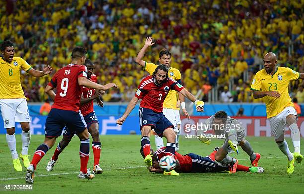 Mario Yepes of Colombia scores a goal past Julio Cesar of Brazil but it is disallowed during the 2014 FIFA World Cup Brazil Quarter Final match...