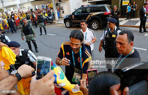 Mario Yepes of Colombia signs autographs as he heads on for a training session at Universidad de Fortaleza Stadium on July 03 2014 in Fortaleza...