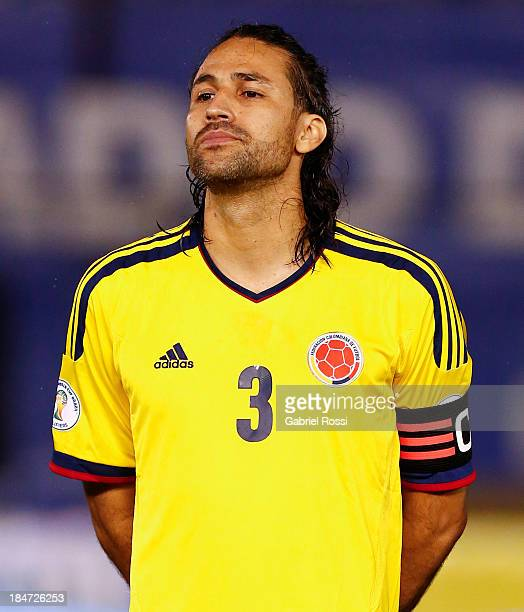 Mario Yepes of Colombia sings the national anthem before a match between Paraguay and Colombia as part of the 18th round of the South American...