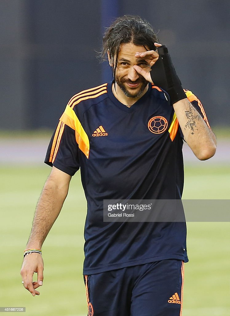 <a gi-track='captionPersonalityLinkClicked' href=/galleries/search?phrase=Mario+Yepes&family=editorial&specificpeople=648682 ng-click='$event.stopPropagation()'>Mario Yepes</a> of Colombia smiles during a training session at Universidad de Fortaleza Stadium on July 03, 2014 in Fortaleza, Brazil. Colombia will face Brazil as part of a 2014 FIFA World Cup Brazil Quarter final match on July 04.