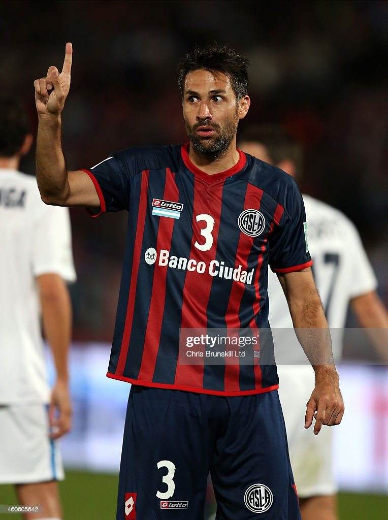 <a gi-track='captionPersonalityLinkClicked' href=/galleries/search?phrase=Mario+Yepes&family=editorial&specificpeople=648682 ng-click='$event.stopPropagation()'>Mario Yepes</a> of San Lorenzo appeals to the assistant referee during the FIFA Club World Cup Semi Final match between CA San Lorenzo and Auckland City FC at Marrakech Stadium on December 17, 2014 in Marrakech, Morocco.