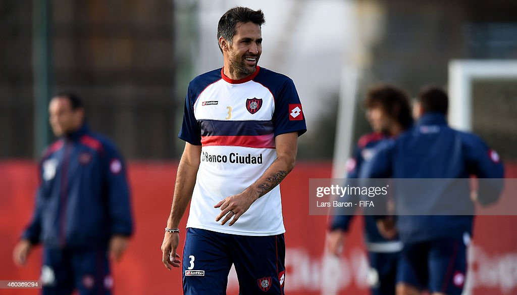<a gi-track='captionPersonalityLinkClicked' href=/galleries/search?phrase=Mario+Yepes&family=editorial&specificpeople=648682 ng-click='$event.stopPropagation()'>Mario Yepes</a> of San Lorenzo smiles during a San Lorenzo training session prior to there first match in the FIFA Club World Cup on December 12, 2014 in Marrakech, Morocco.