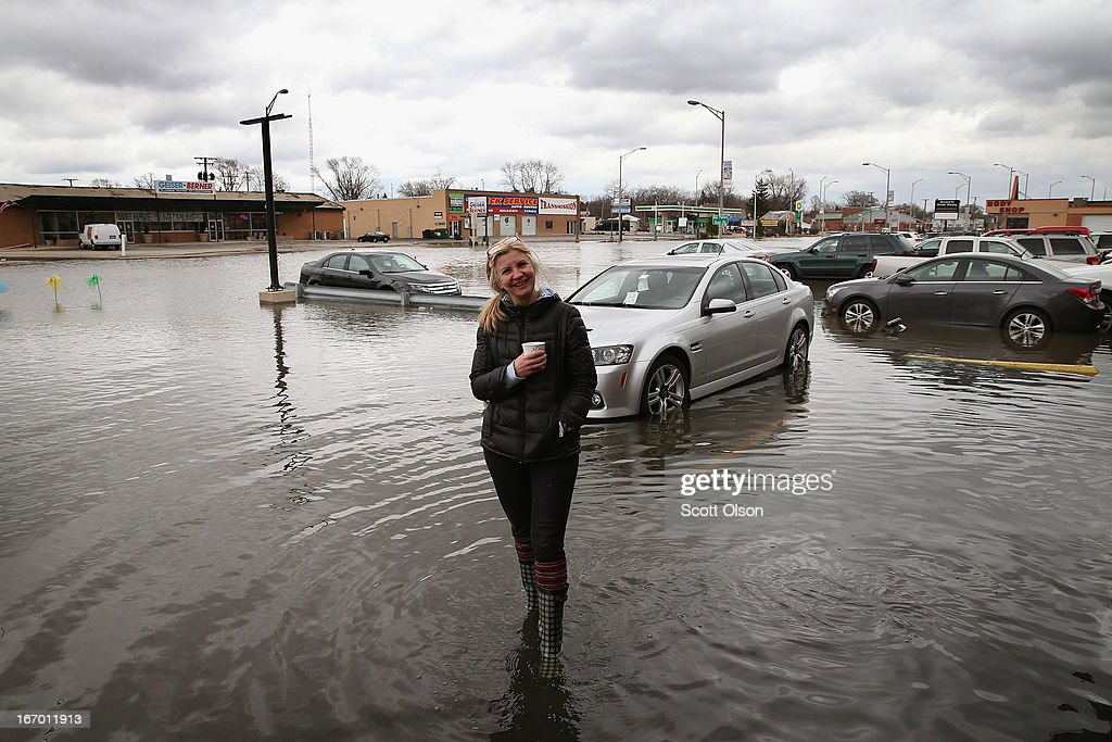 Mariola Wawreszuk surveys flood damage to her strip mall on April 19, 2013 in Des Plaines, Illinois. The suburban Chicago town is battling floodwater from the Des Plaines River which is expected to crest at a record 11 feet later today. Record-setting rains and rising rivers have caused wide-spread flooding in many Illinois communities.