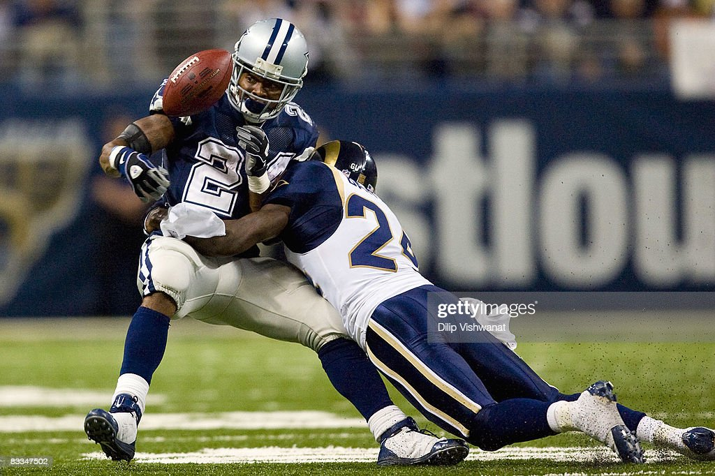 Marion Barber #24 of the Dallas Cowboys has the ball knocked loose by ...