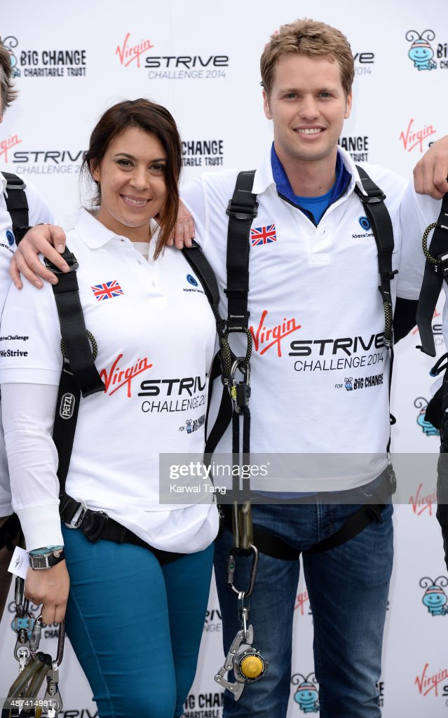 Marion Bartoli and Sam Branson attend a photocall to launch the Virgin STRIVE Challenge held at the 02 Arena on April 30, 2014 in London, England.