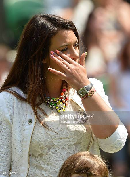 Marion Bartoli attends the Julia Glushko v Sabine Lisicki match on centre court during day two of the Wimbledon Championships at Wimbledon on June 24...