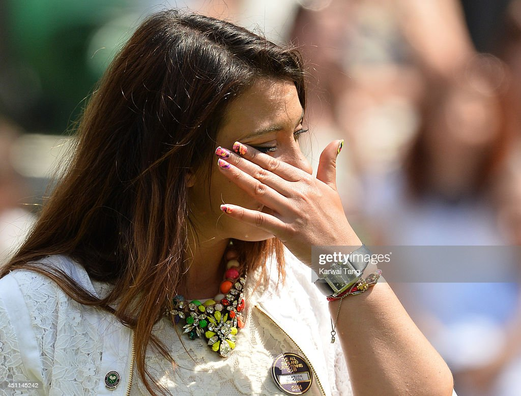 <a gi-track='captionPersonalityLinkClicked' href=/galleries/search?phrase=Marion+Bartoli&family=editorial&specificpeople=227896 ng-click='$event.stopPropagation()'>Marion Bartoli</a> attends the Julia Glushko v Sabine Lisicki match on centre court during day two of the Wimbledon Championships at Wimbledon on June 24, 2014 in London, England.