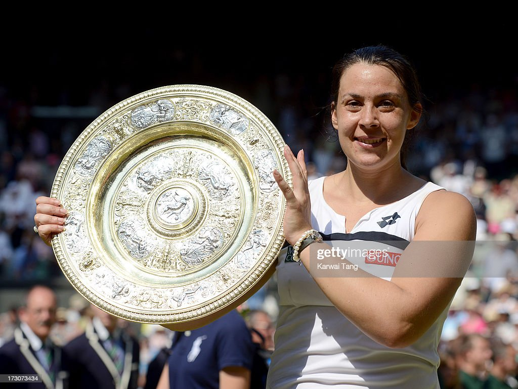 <a gi-track='captionPersonalityLinkClicked' href=/galleries/search?phrase=Marion+Bartoli&family=editorial&specificpeople=227896 ng-click='$event.stopPropagation()'>Marion Bartoli</a> celebrates with her trophy after beating Sabine Lisicki in the Ladies Singles Final on Day 12 of the Wimbledon Lawn Tennis Championships at the All England Lawn Tennis and Croquet Club on July 6, 2013 in London, England.