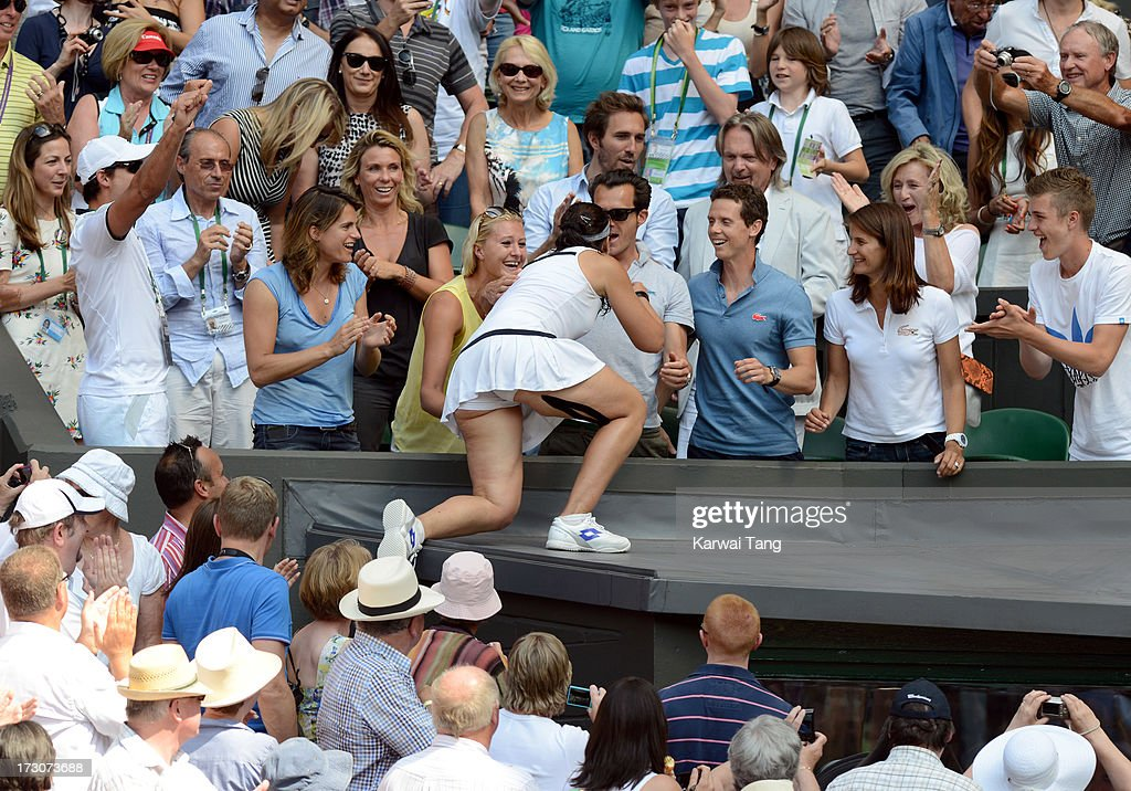 Marion Bartoli climbs up to the family box after beating Sabine Lisicki in the Ladies Singles Final on Day 12 of the Wimbledon Lawn Tennis Championships at the All England Lawn Tennis and Croquet Club on July 6, 2013 in London, England.