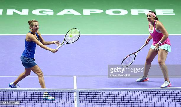Marion Bartoli of France and Iva Majoli of Croatia in action against Martina Navratilova and Tracy Austin of the United States in the WTA Legends...