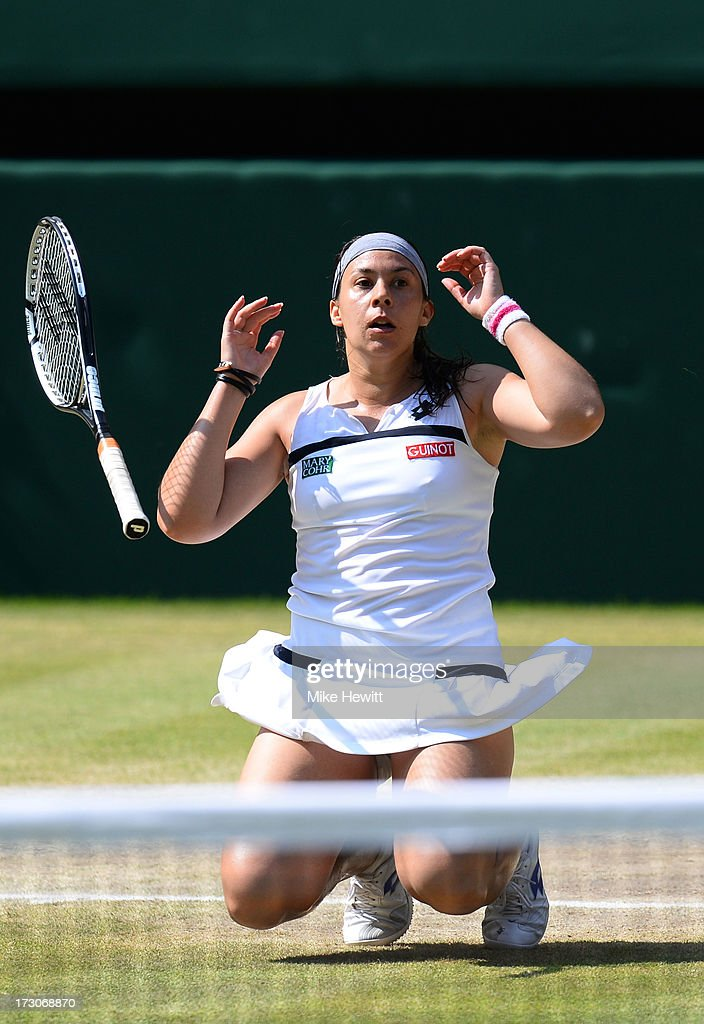 Marion Bartoli of France celebrates match point during the Ladies' Singles final match against Sabine Lisicki of Germany on day twelve of the Wimbledon Lawn Tennis Championships at the All England Lawn Tennis and Croquet Club on July 6, 2013 in London, England.