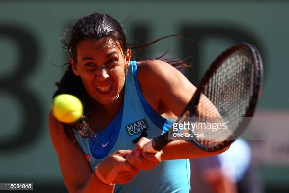 Marion Bartoli of France hits a backhand during the women's singles semi final match between Marion Bartoli of France and Francesca Schiavone of...