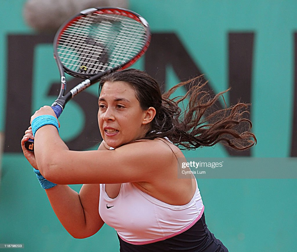 <a gi-track='captionPersonalityLinkClicked' href=/galleries/search?phrase=Marion+Bartoli&family=editorial&specificpeople=227896 ng-click='$event.stopPropagation()'>Marion Bartoli</a>, of France, in action, defeating <a gi-track='captionPersonalityLinkClicked' href=/galleries/search?phrase=Elena+Dementieva&family=editorial&specificpeople=202670 ng-click='$event.stopPropagation()'>Elena Dementieva</a> of Russia, 6-2, 6-4, in the third round of the French Open, Roland Garros, Paris, France