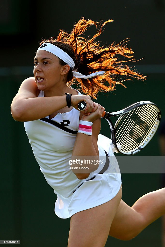 <a gi-track='captionPersonalityLinkClicked' href=/galleries/search?phrase=Marion+Bartoli&family=editorial&specificpeople=227896 ng-click='$event.stopPropagation()'>Marion Bartoli</a> of France plays a backhand during her Ladies' Singles second round match against Christina Mchale of the United States of America on day three of the Wimbledon Lawn Tennis Championships at the All England Lawn Tennis and Croquet Club on June 26, 2013 in London, England.