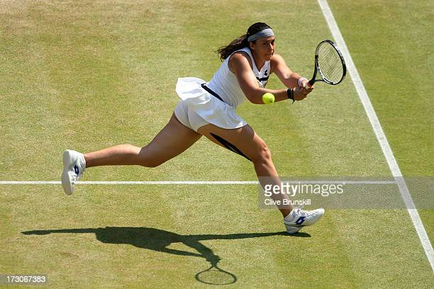 Marion Bartoli of France plays a backhand during the Ladies' Singles final match against Sabine Lisicki of Germany on day twelve of the Wimbledon...