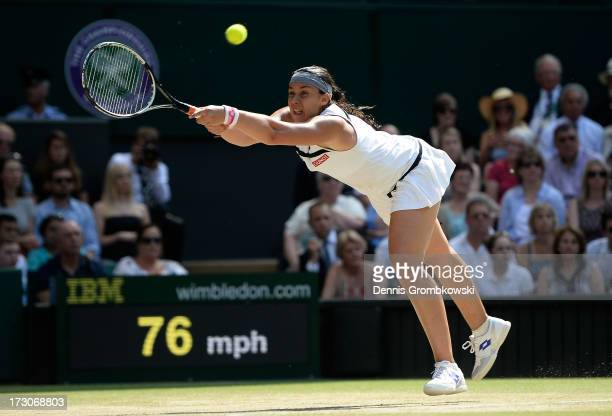 Marion Bartoli of France plays a forehand during the Ladies' Singles final match against Sabine Lisicki of Germany on day twelve of the Wimbledon...