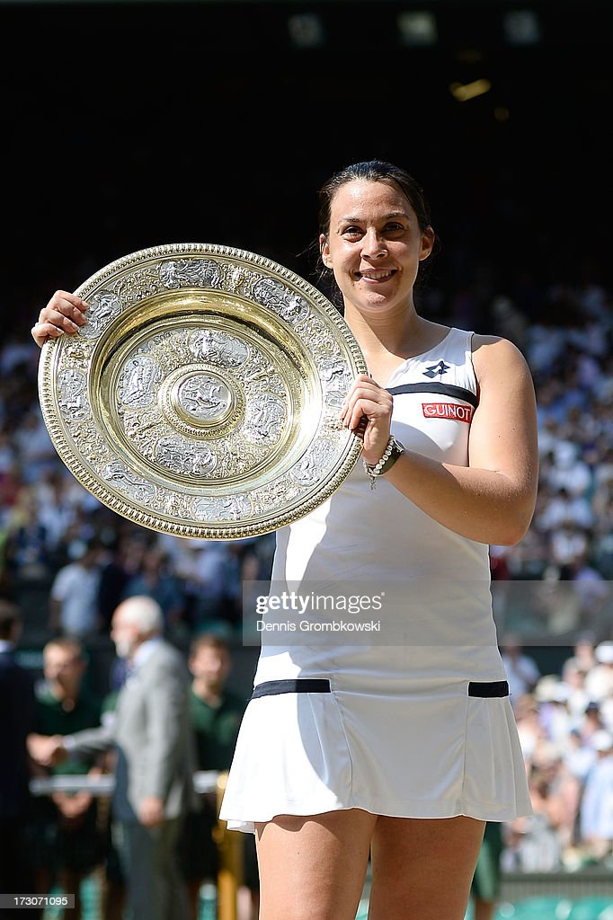 <a gi-track='captionPersonalityLinkClicked' href=/galleries/search?phrase=Marion+Bartoli&family=editorial&specificpeople=227896 ng-click='$event.stopPropagation()'>Marion Bartoli</a> of France poses with the Venus Rosewater Dish trophy after her victory in the Ladies' Singles final match against Sabine Lisicki of Germany on day twelve of the Wimbledon Lawn Tennis Championships at the All England Lawn Tennis and Croquet Club on July 6, 2013 in London, England.