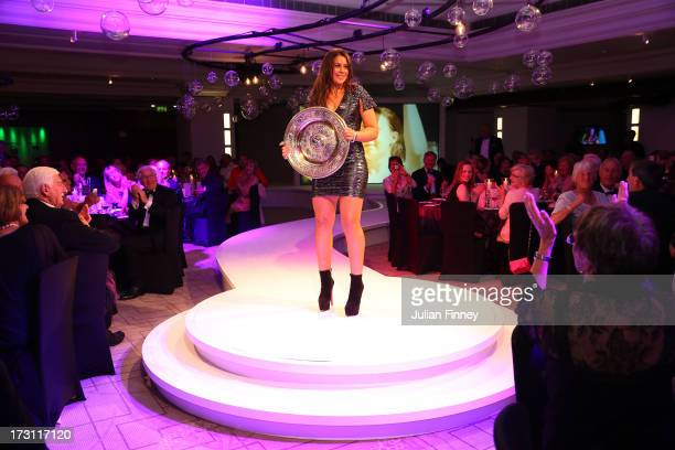 Marion Bartoli of France poses with the Venus Rosewater Dish trophy at the Wimbledon Championships 2013 Winners Ball at InterContinental Park Lane...