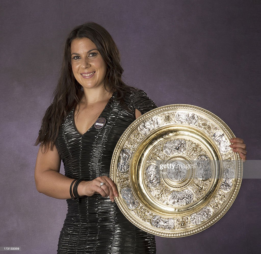 Marion Bartoli of France poses with the Venus Rosewater Dish trophy at the Wimbledon Championships 2013 Winners Ball at InterContinental Park Lane Hotel on July 7, 2013 in London, England.