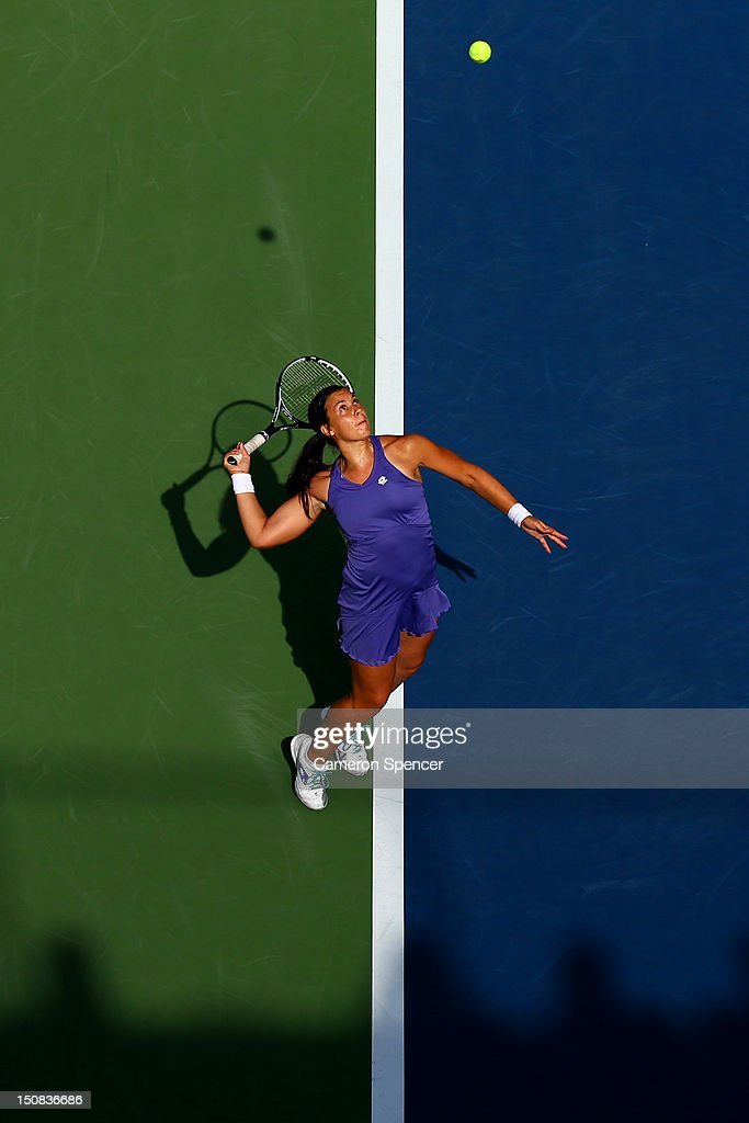 <a gi-track='captionPersonalityLinkClicked' href=/galleries/search?phrase=Marion+Bartoli&family=editorial&specificpeople=227896 ng-click='$event.stopPropagation()'>Marion Bartoli</a> of France serves during her women's singles first round match against Jamie Hampton of the United States during Day One of the 2012 US Open at USTA Billie Jean King National Tennis Center on August 27, 2012 in the Flushing neigborhood of the Queens borough of New York City.
