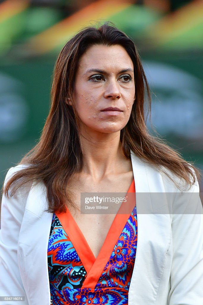 Marion Bartoli waits to interview Stan Wawrinka during the Men's Singles third round on day six of the French Open 2016 at Roland Garros on May 27, 2016 in Paris, France.