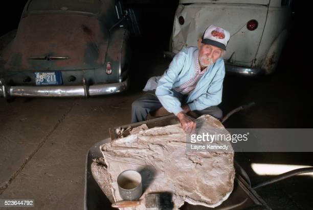Marion Bonner Works on Mososaur Fragment
