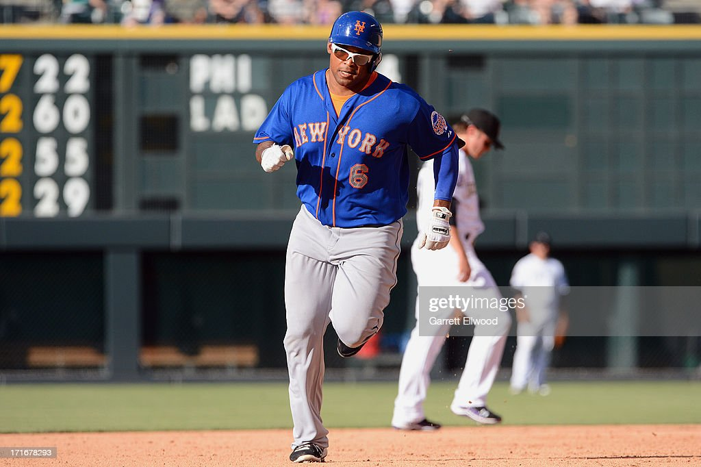 Marion Byrd #6 of the New York Mets rounds second base after hitting a two-run home run in the eighth inning during the game against the Colorado Rockies at Coors Field on June 27, 2013 in Denver, Colorado. Photo by Garrett W. Ellwood/Getty Images)