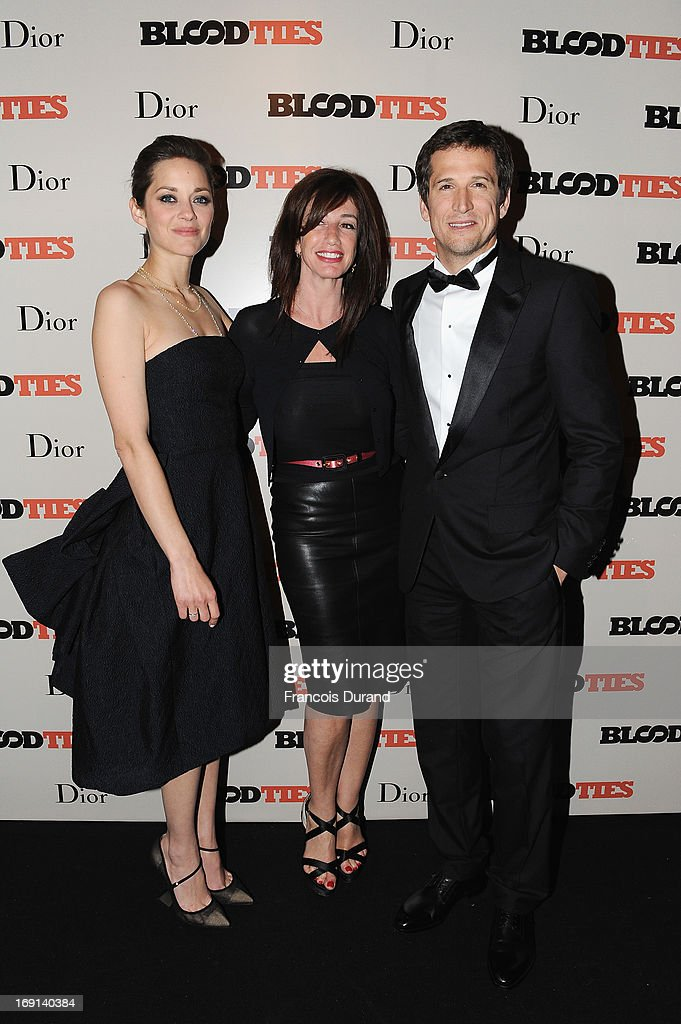 Marion Cotillard, Albane Cleret and Guillaume Canet attend the 'Blood Ties' cocktail and party hosted by Dior at Club by Albane in Bulgari Rooftop on May 20, 2013 in Cannes, France.