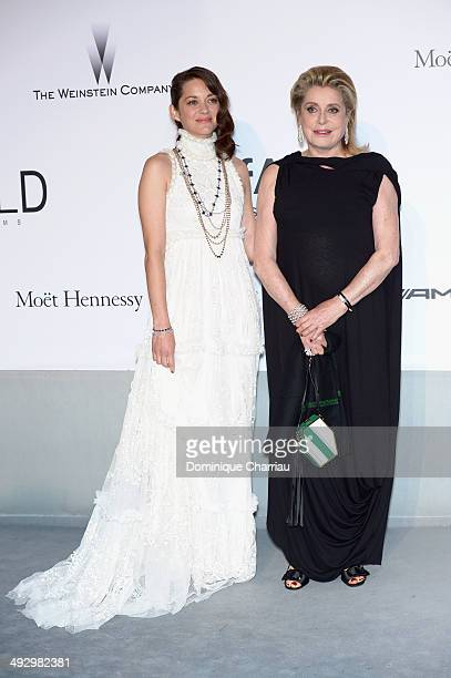 Marion Cotillard and Catherine Deneuve attend amfAR's 21st Cinema Against AIDS Gala Presented By WORLDVIEW BOLD FILMS And BVLGARI at Hotel du...