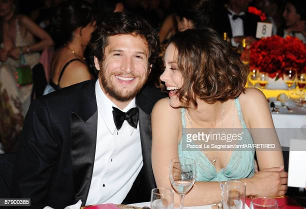 Marion Cotillard and Guillaume Canet attend the amfAR Cinema Against AIDS 2009 dinner at the Hotel du Cap during the 62nd Annual Cannes Film Festival...