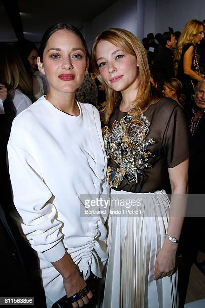 Marion Cotillard and Haley Bennett attend the Christian Dior show as part of the Paris Fashion Week Womenswear Spring/Summer 2017 on September 30...