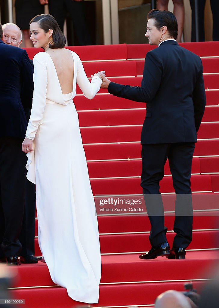 Marion Cotillard and Jeremy Renner attend 'The Immigrant' Premiere during the 66th Annual Cannes Film Festival at Grand Theatre Lumiere on May 24, 2013 in Cannes, France.