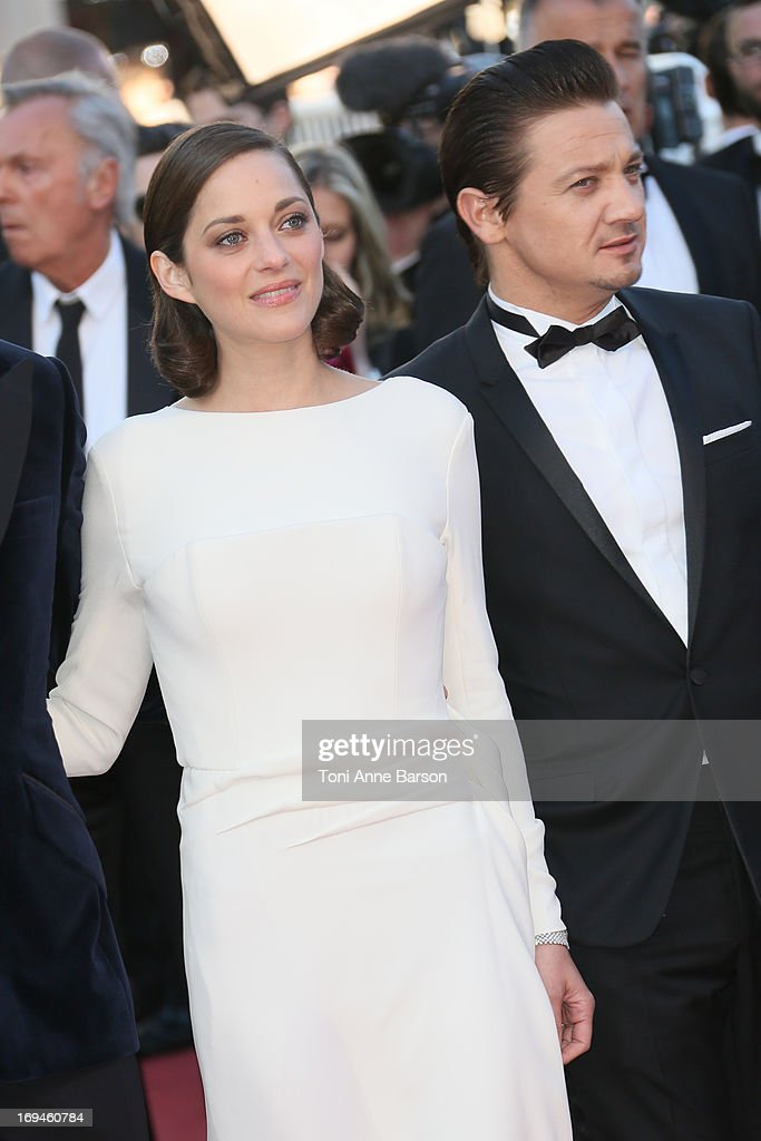 Marion Cotillard and Jeremy Renner attends the premiere of 'The Immigrant' at The 66th Annual Cannes Film Festival on May 24, 2013 in Cannes, France.