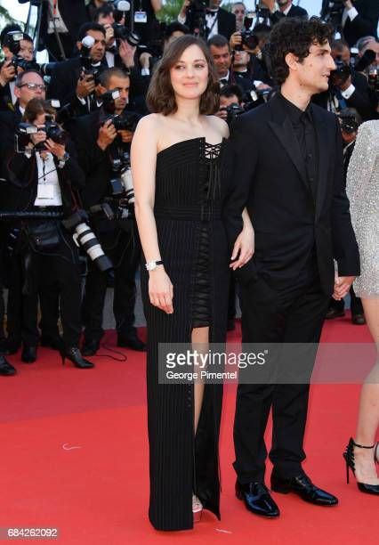 Marion Cotillard and Louis Garrel attend the 'Ismael's Ghosts ' screening and Opening Gala during the 70th annual Cannes Film Festival at Palais des...