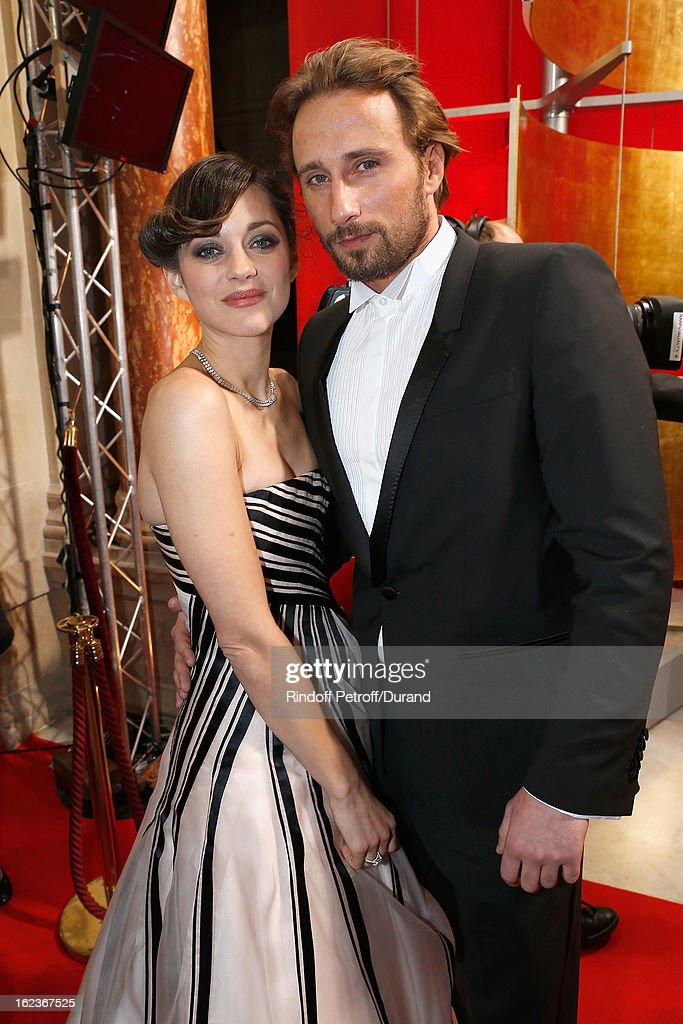Marion Cotillard (L) and Matthias Schoenaerts pose after they arrived to attend the Cesar Film Awards 2013 at Theatre du Chatelet on February 22, 2013 in Paris, France.