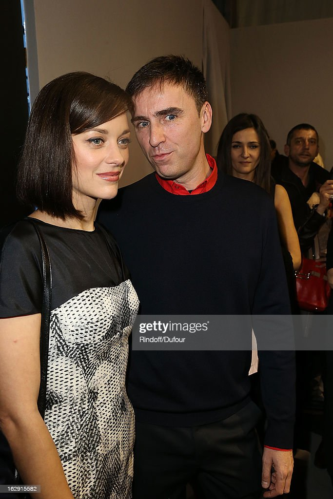 Marion Cotillard and Raf Simons attend the Christian Dior Fall/Winter 2013 Ready-to-Wear show as part of Paris Fashion Week on March 1, 2013 in Paris, France.