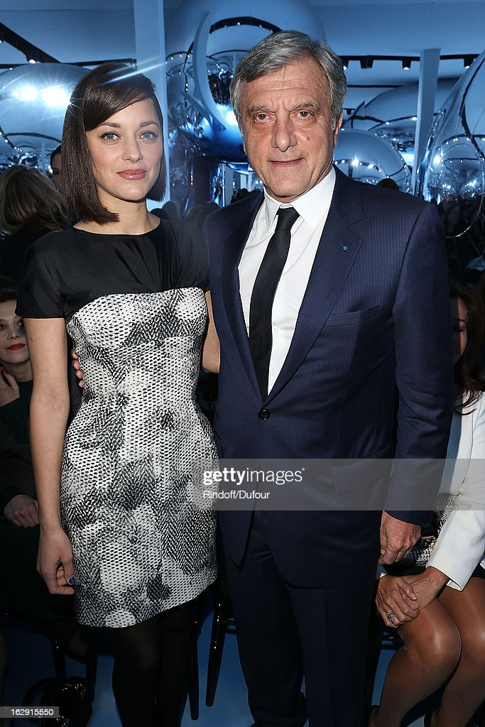 Marion Cotillard and Sidney Toledano attend the Christian Dior Fall/Winter 2013 Ready-to-Wear show as part of Paris Fashion Week on March 1, 2013 in Paris, France.