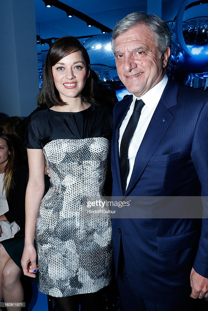 Marion Cotillard and Sidney Toledano, Christian Dior Couture President and CEO attend the Christian Dior Fall/Winter 2013 Ready-to-Wear show as part of Paris Fashion Week on March 1, 2013 in Paris, France.