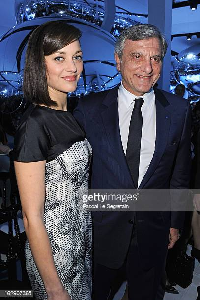 Marion Cotillard and Sydney Toledano attend the Christian Dior Fall/Winter 2013 ReadytoWear show as part of Paris Fashion Week on March 1 2013 in...